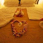 Flower arrangements on our bed after the proposal dinner!