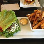 Yummy bison burger with a lettuce wrap and yam fries