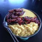 Breakfast: chorizo, polenta, roasted tomatoes, scrambled eggs.