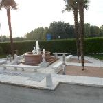 Garden and fountain at front of hotel..