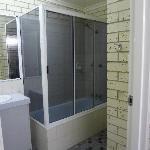 Full size bathroom with bath