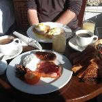 Breakfast - full English (foreground) and Eggs Benedict (background)