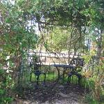 Secluded gazebo with wrought iron furniture.