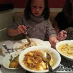 Our youngest daughter demolishing a curry!