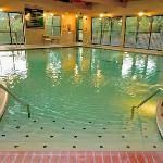 Large indoor swimming pool and spa with a lap area.