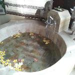 Grand bath tub with fresh fragrant flowers upon arrival