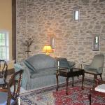 large living room with stone wall