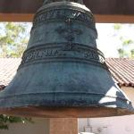 A bell in the garden behind.