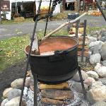 Making the apple butter that they sell in their shops.