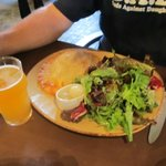 A suffed popover, salad and local beer