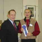 President Rufus Lazzell greeting winner of Art Show