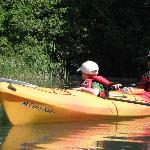 Kids ride in tandem kayak