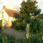Saule set in sunny flower filled mature gardens, surrounded by far reaching views