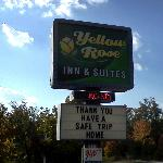 Yellow Rose sign in parking lot
