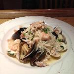 A JWs Special: Mussels, Shrimp and Crab meat in a white wine garlic sauce over cappellini pasta