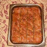 Tray of fresh baklava, phyllo dough, walnuts, honey syrup.