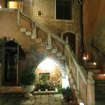 Nighttime view of stairs/courtyard with lit candles