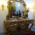 A Beautiful hallway mirror and table