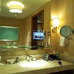 Love the TV in bathroom mirror.