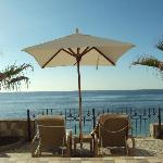 Private beach chairs and umbrella; view of Old Man's
