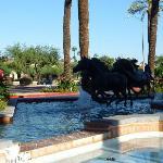 Horse statues outside entrance.