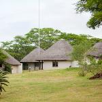 Rondavel styled rooms at Safari Lodge sprawled out on open Lawns