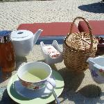 Honey farm lemon grass tea, honey and scone in basket