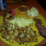 2 scrambled eggs with bacon, toast, apples, beans, home fries and fruit