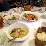 two curry dishes, phad thai, and sticky rice