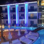 Hotel pool area lit up at night
