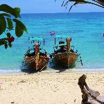 longboats on private beach