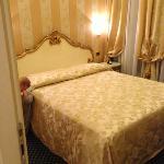 """king bedroom of """"triple"""" room"""