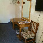 The custom made desk and handmade custom chair in the room