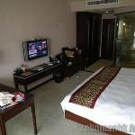 Spacious room with digital TV and 2 free cans of softdrink per day