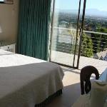 En-suite with view on Table Mountain, led dstv, wireless internet, hospitality tray, bar fridge.