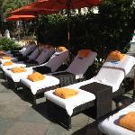 loungers outside the cabanas