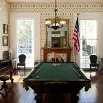 Antebellum Billiard Hall featuring an antique billiard table for guests.