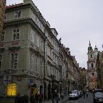 View from Charles bridge back to hotel. Small grocery store next door.