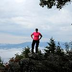 Melissa on a rock at the top of the mountain
