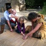 learning how to sew a new door for an Indian dwelling