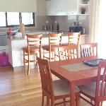 Dining area and kitchen - note the beautiful natural light