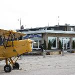 DeHavilland Tiger Moth parked outside the Cafe