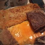 Big, hearty breakfast: ham/cheese omelet, rye toast, hashbrowns, coffee.