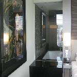 Open bathroom leading into the bedroom