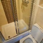 Narrow shower door and suite