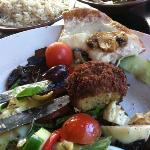 several menu items- cheesy bruschetta, Mediterranean Salad, Falafel and Rice Pilaf