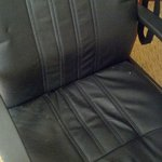 Dirty office chair with crumbs and stains.