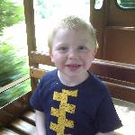 My gorgeous boy enjoying a ride on Bella the train
