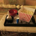The owner made us popcorn while we were at dinner so we could have a snack and watch a movie.