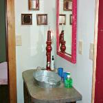 Shot of galvanized sink in bathroom.